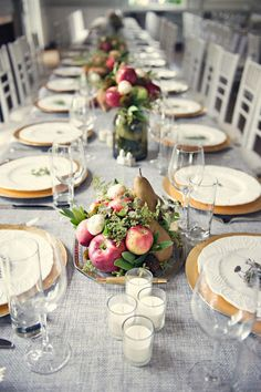 Centerpieces are a nod to traditional harvest-themed decor while the blue gray tablecloth adds an unexpected dose of soothing color. The gold plates dress up the table and tie in with the centerpieces perfectly. Ideas for a Unique Thanksgiving Tablescape Fruit Centerpieces, Thanksgiving Centerpieces, Wedding Centerpieces, Wedding Decorations, Centerpiece Ideas, Fruit Arrangements, Flower Arrangement, Flower Centrepieces, Holiday Tablescape