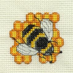 Google Image Result for http://fc01.deviantart.net/fs43/f/2009/088/f/f/Bee_Cross_Stitch_by_DawnMLC.jpg
