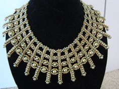 24 kp beads and Swarovski pearls. Lot of work, but well worth it. Pattern by Shelly Nybakke