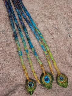 peacock dread extentions....not gonna lie, If I EVER had dreads, I would SOO be getting these :)