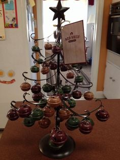 Rustic Jingle Bell Metal Christmas Tree from Tractor Supply is what I have on my kitchen table this year.