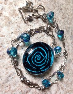 Brilliant Teal Blue Glass Bead on Silver Blue Sparkle Chain Necklace on Etsy, $20.00