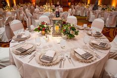 Blush wedding tabletop decoration.  Romantic, elegant and luxurious tablecloths, mocha glass charger plates and fresh floral lantern centerpieces.  Embassy Suites, East Peoria, IL.