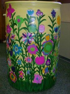 I wish I was this artistic! What a beautiful rain barrel...it beats the pants off of my drab gray recycled rain barrel