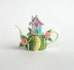 This miniature sweetheart house on hill teapot is a one of a kind original design and creation by artist C. Rohal. It is completely hand made,