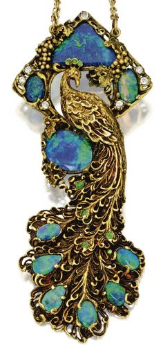 Gold, Black Opal, Diamond and Demantoid Garnet Peacock Pendant-Necklace, Walton & Co., Circa 1900. The stylised peacock amidst a grapevine motif set with triangular-shaped, oval and pear-shaped black opals, accented by old European-cut diamonds and various-cut demantoid garnets, length 15¾ inches, signed Walton & Co. #Walton #ArtNouveau #pendant