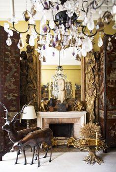 Coco Chanel: a gilt-covered woodland scene frames the salon's marble mantelpiece   domino.com