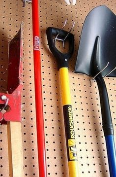 Rather than prop shovels and rakes in the corner of your garage or shed, install pegboard and hang them up with hooks made for the job.