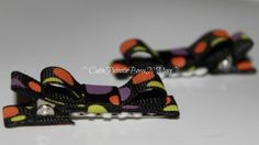 Black, pink, green, and purple clips.  $3.00