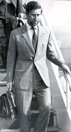 Prince Charles, sporting designer stubble, as he arrived in Canada in 1975 for three weeks of military exercises Designer Stubble, Morning Suits, Morning Dress, Tom Ford Suit, Elisabeth Ii, Canadian History, Blue Suede Shoes, Duchess Of Cornwall, Sharp Dressed Man