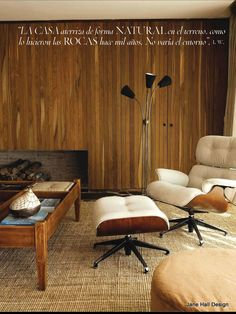 Mid Century Modern living room featured in Spain Architectural Digest - love the chair!