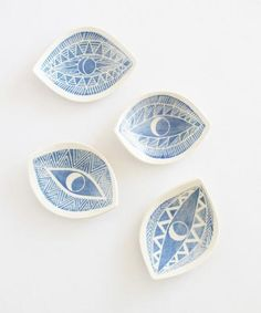 A hand-sculpted porcelain dish with carved graphic eye motifs perfect for displaying your favorite treasures. Each handmade piece is unique, sculpted shapes and carvings are individual to each piece.