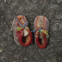 """Photograph by Shannon Jensen—Getty Images  Shannon Jensen's project, """"A Long Walk,"""" saw her visit refugee camps in northeast South Sudan. Aiming to document the plight of refugees fleeing both the Blue Nile and South Kordofan, Jensen took an unusual tack: Instead of photographing the refugees themselves, she focused on their worn-out shoes, which she believes are visceral reminders of the struggle of displaced people. The images that emerge are as simple as they are haunting. Pictured are…"""