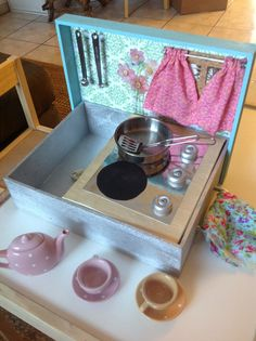 DIY tabletop travel kitchen toy from a Michael's wooden box, scrapbook paper, fabric scraps, and accessories.