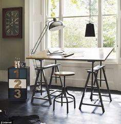 very cool workspace. love the vintage drafting table and stool and the 1 2 3 drawers are super cool