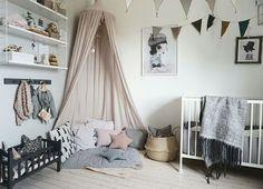 Girl's nursery in soft tones - nordic style