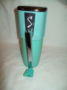 Vintage ice crusher - ours was pink - in our aqua kitchen
