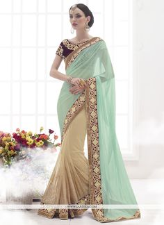Aspiring to make a mark in the world of style! Here is the attire to breath life into your aspirations. Steal the hearts away with this beige net and lycra designer saree. The embroidered, patch borde...