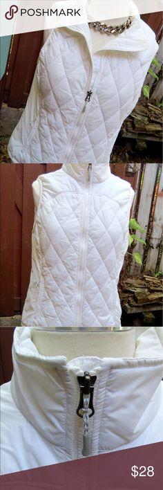 Eddie Bauer Quilted Puffer Vest Sz M Camping Ladies' quilted puffer vest by Eddie Bauer, size M. Crisp white color and very warm and comfortable. Multiple side pulls for the perfect fit. Front pockets for storage. Inside lined so it's smooth and soft. Great for any outdoor excursion.   Very good preowned condition. No rips, stains or tears. One of the pocket zippers is missing the little rope pull. From a smoke-free home.  I love to work deals, so feel free to bundle and we'll work out a…