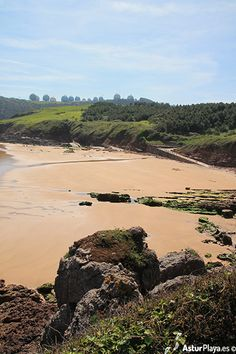 """The Second Beach of Xivares (Peña María) in Asturias, Spain on a spring day. With low tide it joins its """"sister"""" The Second beach of Xivares which is not nudist."""