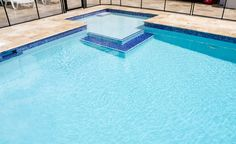 pool-decks-peerless-water-line-tile-for-swimming-pools-with-blue-iridescent-glass-pool-tile-also-underwater-light-for-swimming-pool-945x578.jpg (945×578)