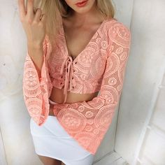 pinterest @esib123  Got an upcoming event? This whole outfit will suit you well . Shop CROSS OVER BANDAGE SKIRT - WHITE, LONG SLEEVE LACE CROP TOP - NEON PEACH, www.stelly.com.au #stellyclothing