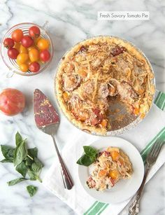 Fresh Savory Tomato Pie. Truly the best summer recipe made with fresh tomatoes, cheese and basil. Fantastic texture and flavors that sing summer. Gluten-free or regular options. - BoulderLocavore.com