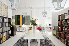 Contemporary Eclectic Work Space: A white conference table with wire-backed chairs on an area rug at Buckingham Interiors + Design in Chicago.