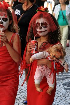 Zombie Walk Curitiba  Brasil....(drinking pop?)   is that a doll or a real baby?    this is picture with questions?