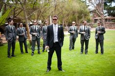Groom in black groomsmen in gray to go with muted tone bridesmaid dresses