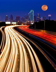 Moon closer to earth. Dallas skyline