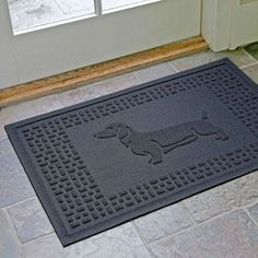Celebrate your favorite dog breed while protecting your floors with the Dachsund Fashion Floor Mat. Use as a dog placemat or entryway mat.