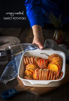 For this simple and beautiful dish sweet potatoes are sliced thin, brushed with butter, and roasted until crisp yet tender. - All that's Jas Crispy Sweet Potato, Paleo Sweet Potato, Sweet Potato Recipes, Roasted Sweet Potatoes, Baked Sweet Potato Slices, Sweet Potato Dinner, Crispy Roast Potatoes, Sweet Potato Chips, Salads