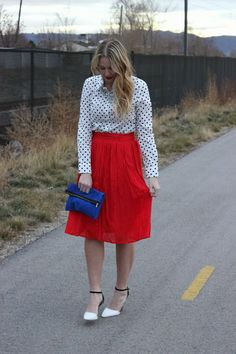 Polka dot blouse and red skirt