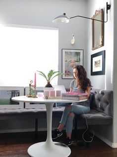 Part of Nichol's design philosophy is about creating zones. By building a banquette in a corner of their living room, she practically created a new room dedicated to homework, breakfast, crafts and hanging out.