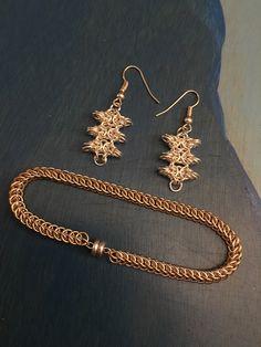 Sterling silver earrings and gold bracelet