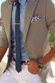 — Light Blue Dress Shirt — Teal Tie — White and Navy Polka Dot Pocket Square — Beige Blazer — Blue Leather Watch — Dark Brown Leather Belt — White Chinos::