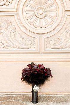 dark calla lillies + black feathers