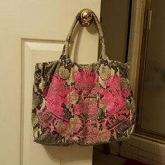 JUICY COUTURE gray and hot pink snakeskin print sa JUICY COUTURE gray and hotpink snakeskin print cloth satchel handbag. Very roomy, measurments are 12h, 15l, and 5d..in EUC Juicy Couture Bags Satchels