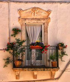 Ancient Balcony, Apulia, Italy photo via pluma Balcon Juliette, Fachada Colonial, Balcony Window, Balcony Garden, Iron Balcony, Balcony Railing, Flower Illustrations, Purple Home, Through The Window