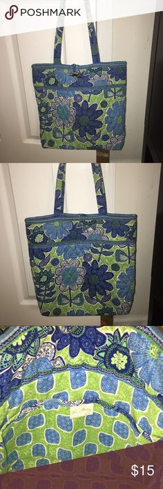 Vera Bradley Shoulder Bag Beautifully and brightly colored Vera Bradley shoulder bag.   Decorated in shades of blues and greens.  Quilted fabric, duel shoulder straps,  with ornate button and loop to secure it shut.  It has a flat base with 3 interior slots to store items. Excellent condition with slight wear on one bottom corner. Vera Bradley Bags Shoulder Bags