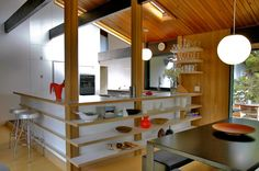 I like how the open shelving and the breakfast bar side match.