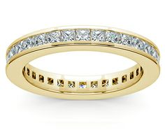Thirty two princess cut diamonds (depending on ring size) are channel set in this classic diamond eternity band in 14k or 18k yellow gold.