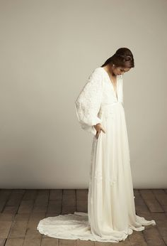 {BEAUTIFUL Boho Style Silk & Embroidered Lace Applique Wedding Gown by Vania Romoff; Gown Features A Narrow Plunging V Neckline, Long Lace Appliqued Blouson Sleeves, & Soft Flowing Silk Lace Appliqued A-Line Skirt With Chapel Length Train···························}