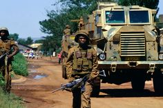 Bekkersdal Township, South Africa, Feb SADF soldiers patrol during three way clashes between security forces, ANC members and AZAPO supporters in the far West Rand township of Bekkerdal, South Africa. Military Weapons, Military Life, Military History, Once Were Warriors, South Afrika, Army Day, Le Far West, Armored Vehicles, Armed Forces