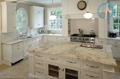 The deep golden and gray veining on the spacious Bianco Romano island is a focal point of this kitchen.