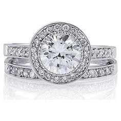 Wedding Ring - At least 1.5 Carat round diamond in a white gold setting and a grade not lower than VVS2. Haha. My groom seriously needs to get his wallet ready! :)