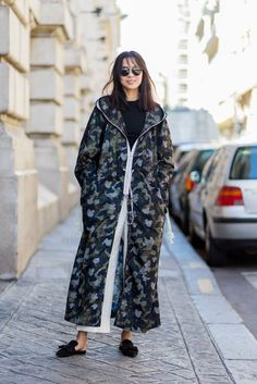 """30 Looks That Show The Many Sides Of """"French Girl"""" Style #refinery29  http://www.refinery29.com/2016/10/125501/pfw-spring-2017-best-street-style-outfits#slide-3  Cozy up in a parka this season. Kate Moss said so...."""