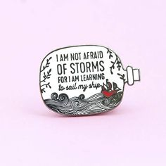 This encouraging pin is a quote from one of my favorite childhood books, Little Women. With its gorgeous woodcarving-inspired style and hopeful message, its perfect for everyone who wants to live a strong and joyful life, fear of fear. Hard enamel with black nickel finish and rubber