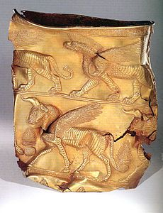 Golden Cup depicting Griffin on top band. Excavated at Marlik, Gilan, Iran. First half of first millennium BC.